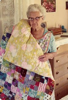 Ivan's grandmother, Bessie Ringer, holding one of many quilts that she made.