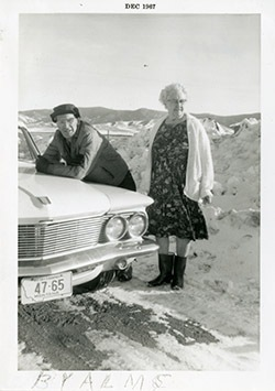 Charlie Doing and Bessie Ringer leaning on a car.