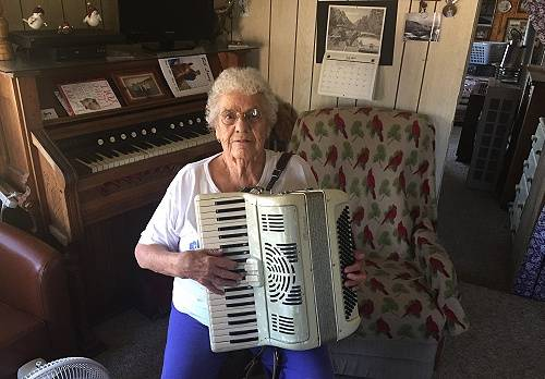 Julia Short playing the accordion