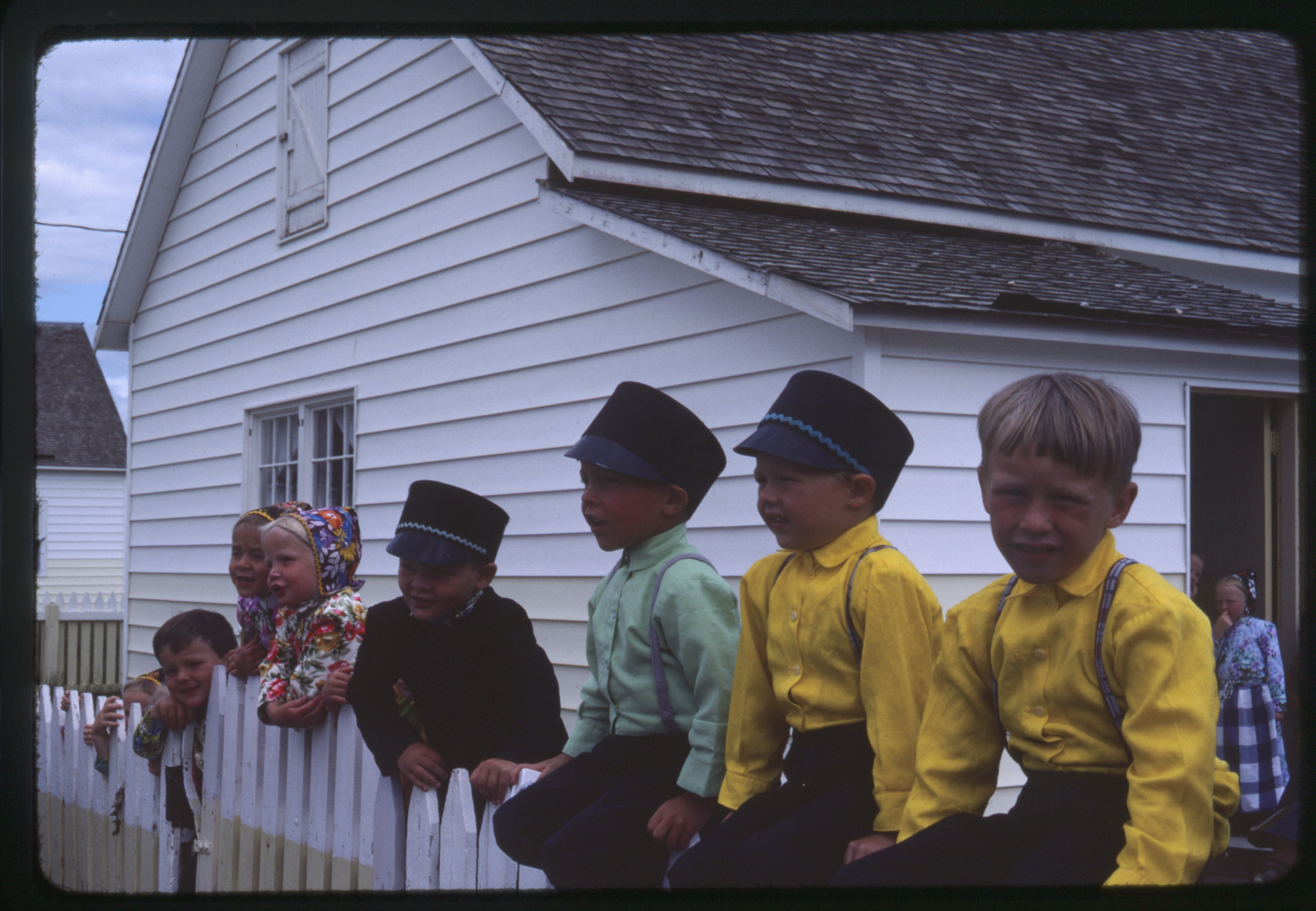 New Rockport Hutterite Colony - kindergarten class sitting on a fence