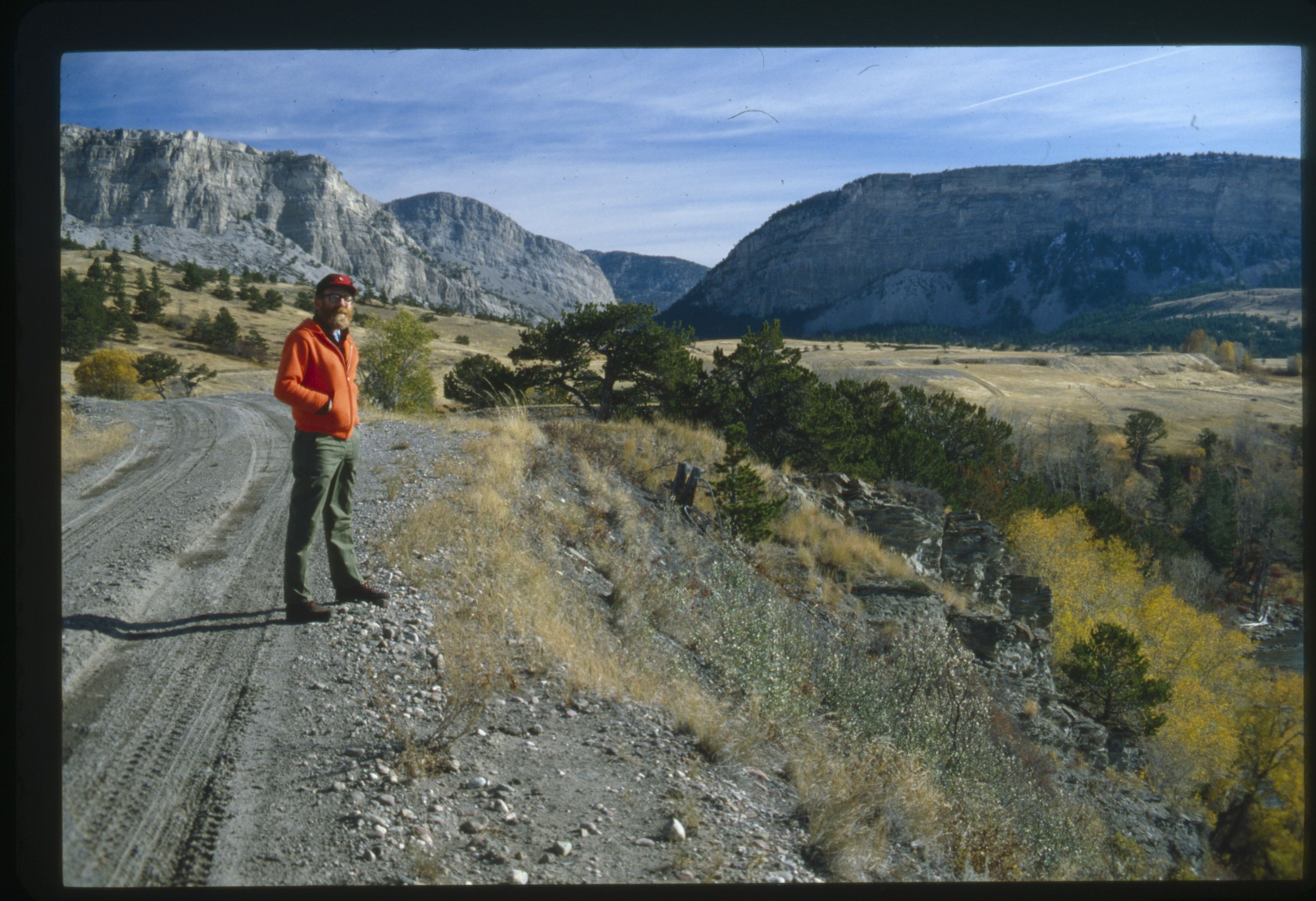 Ivan Doig standing on the side of the road near Sixteen Canyon, Montana